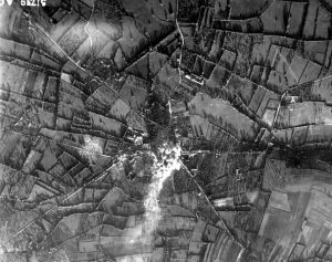 The village of Aunay-sur-Odon as the bombs fell. Source: By Conseil Régional de Basse-Normandie / National Archives USA, Attribution, https://commons.wikimedia.org/w/index.php?curid=16076017